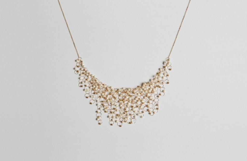 Collana girocollo in oro giallo 18KT e perle d'acqua dolce - Infinito N
